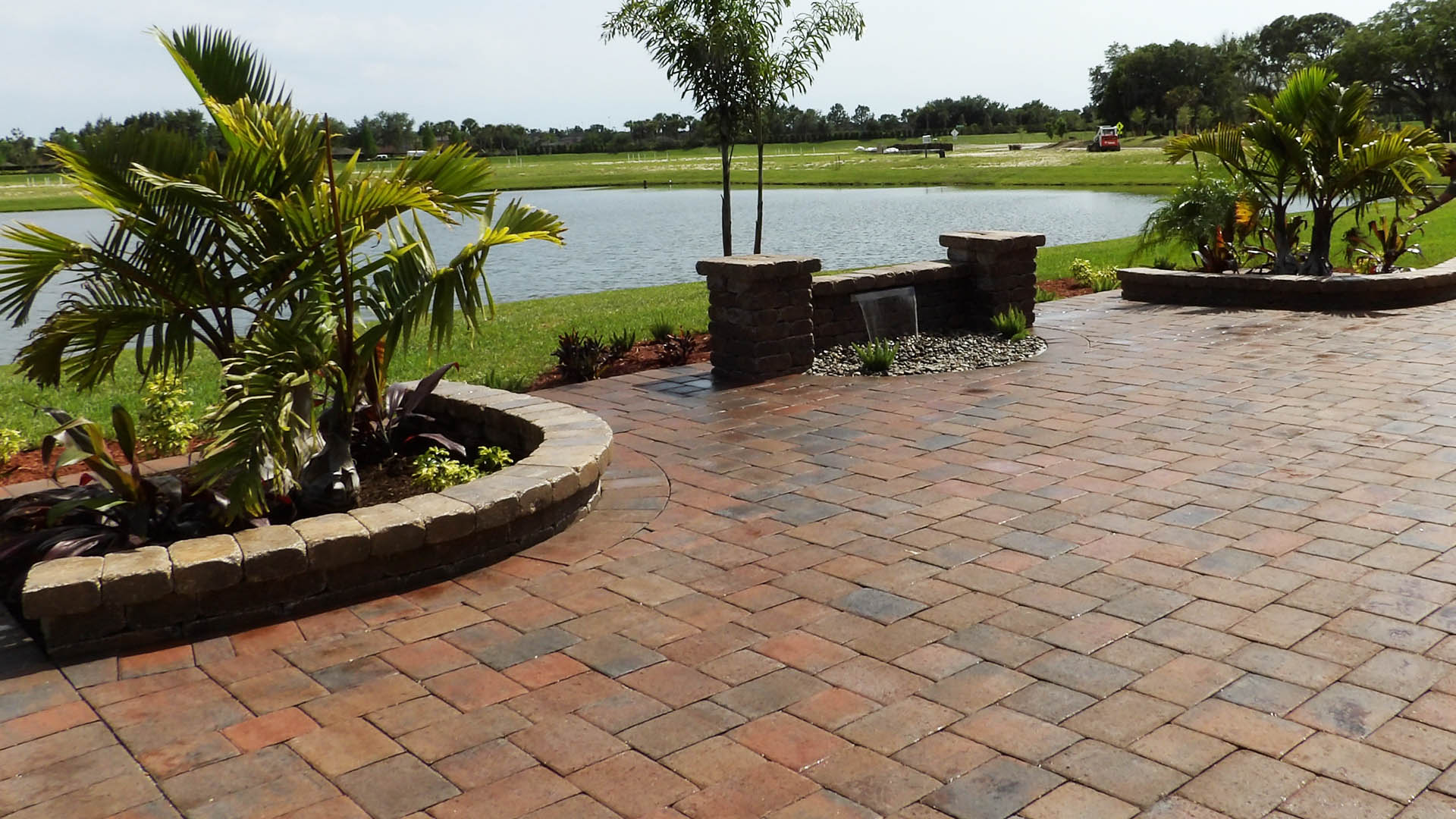 Custom paver patio and waterfall by Three Seasons in Palmetto, FL.