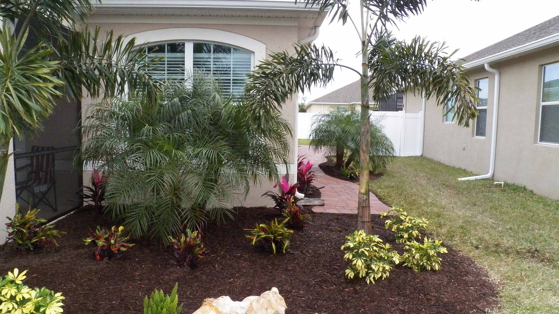 Well maintained home landscape bed in Ellenton, FL.