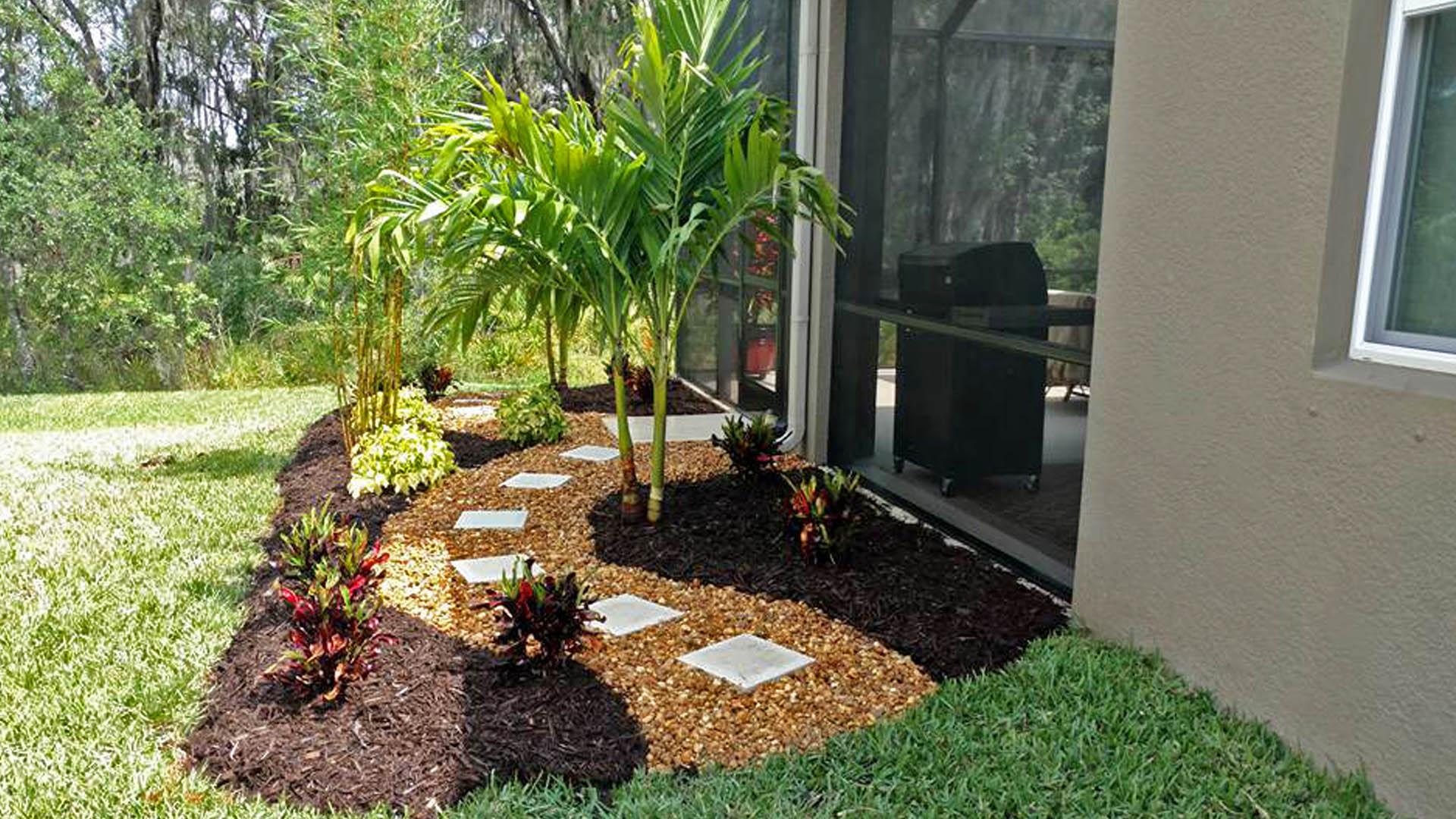 Landscape bed with rock and mulch.