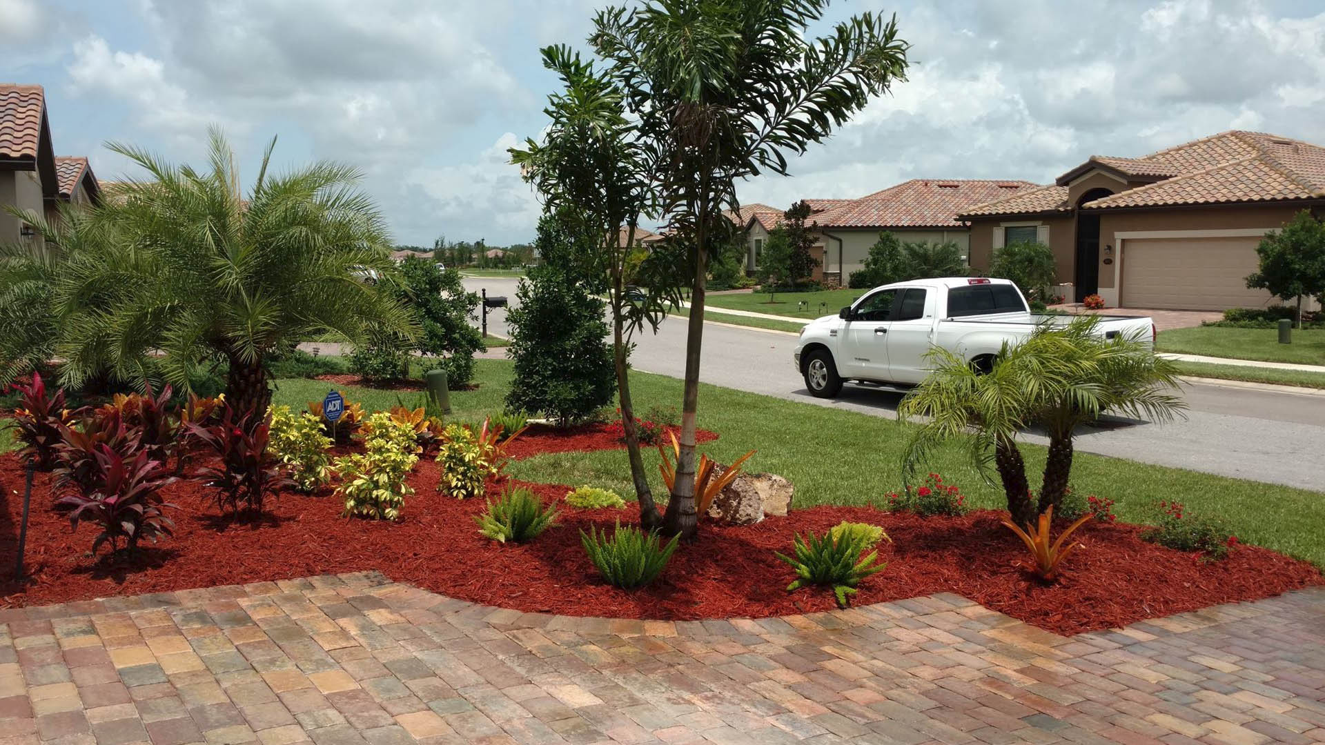 New landscaping in round bed by Three Seasons in Palmetto, FL.