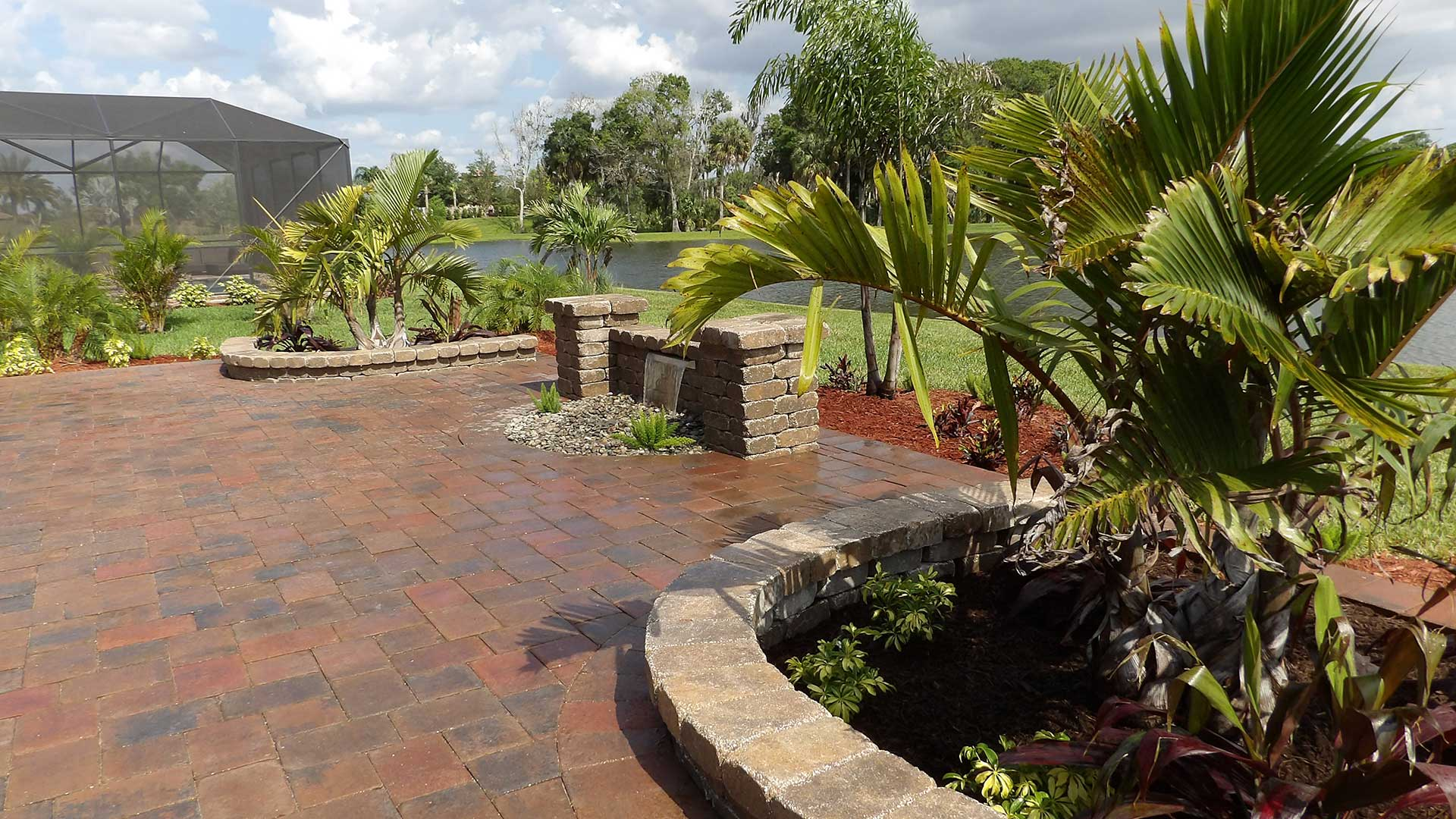 Custom patio, retaining wall, and landscape design in Sarasota, FL.