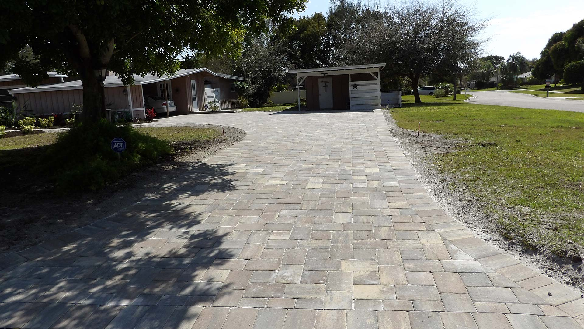 Custom paver driveway installation at a home in Palmetto, FL.