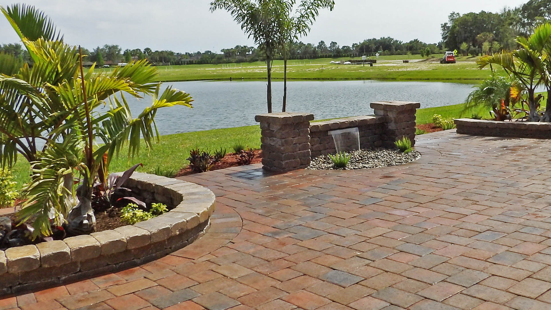 Custom brick waterfall on patio by Three Seasons in Palmetto, FL.
