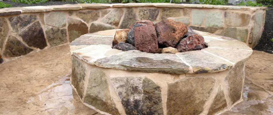 Custom designed and built fire-pit in the backyard of a homeowner in Palmetto