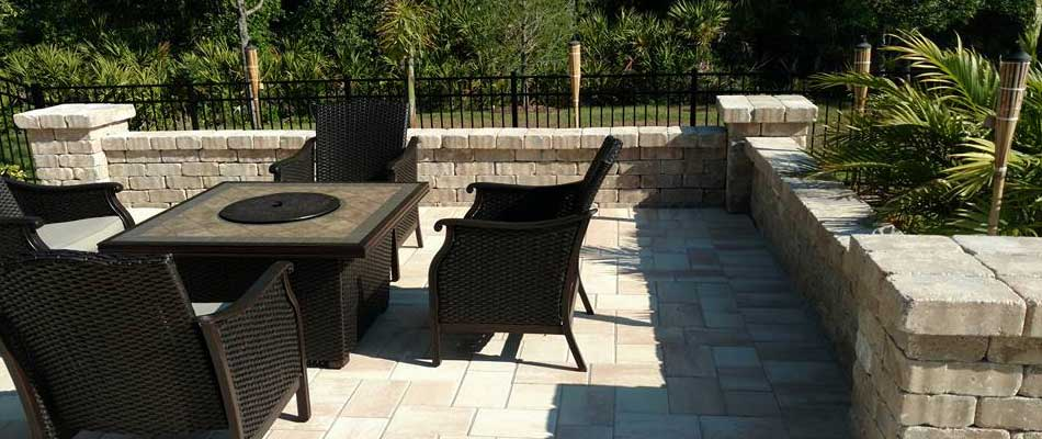 Stone seating wall and patio with furniture in Palmetto, FL.