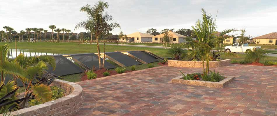 Custom patio construction with retaining walls in Lakewood Ranch, FL.