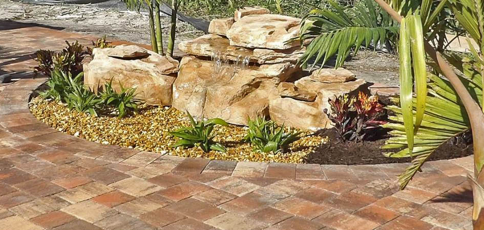 Custom rock/boulder waterfall on residential property in Palmetto, FL.