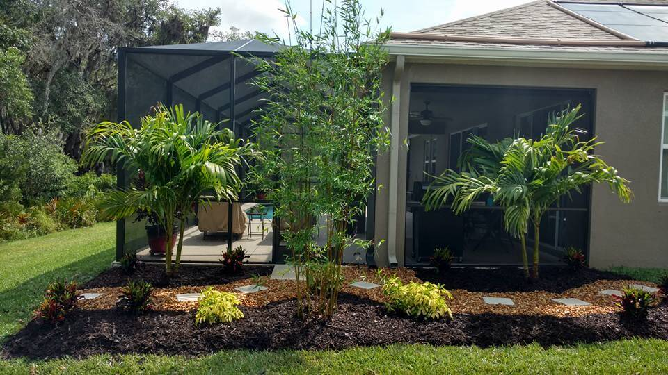 Create privacy with landscaping and stop erosion around pool home in Palmetto, FL.
