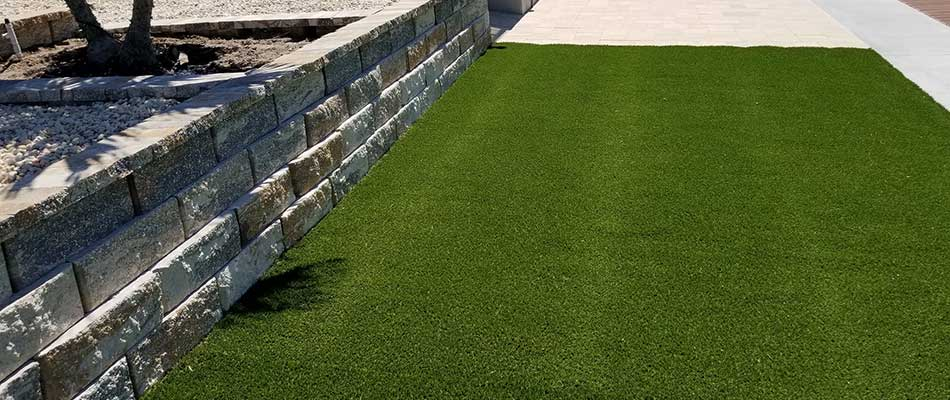 New artificial turf in Palmetto, FL means the homeowner will have less yard maintenance to worry about.