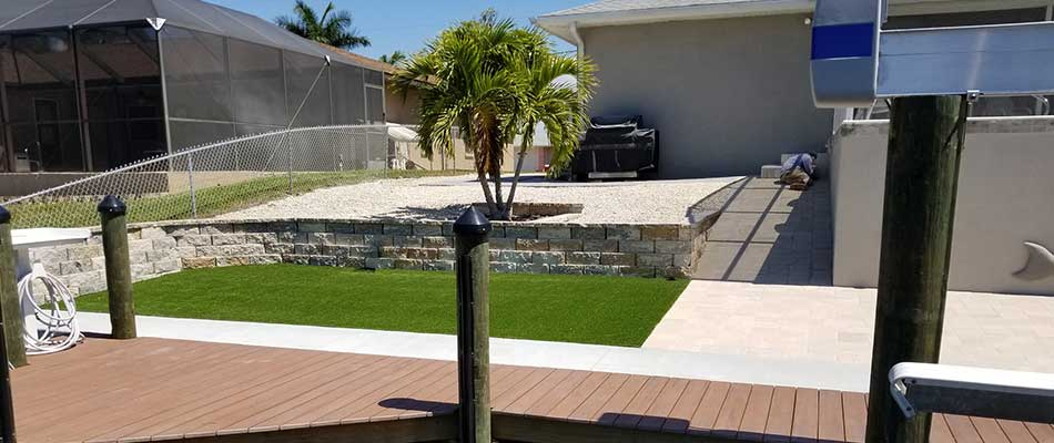New Landscape Bed & Artificial Turf at Palmetto, FL Waterfront Property