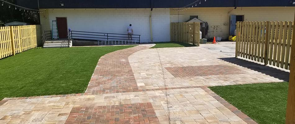Custom paver patio and artificial turf installed at Three Keys Brewery in Bradenton, FL.